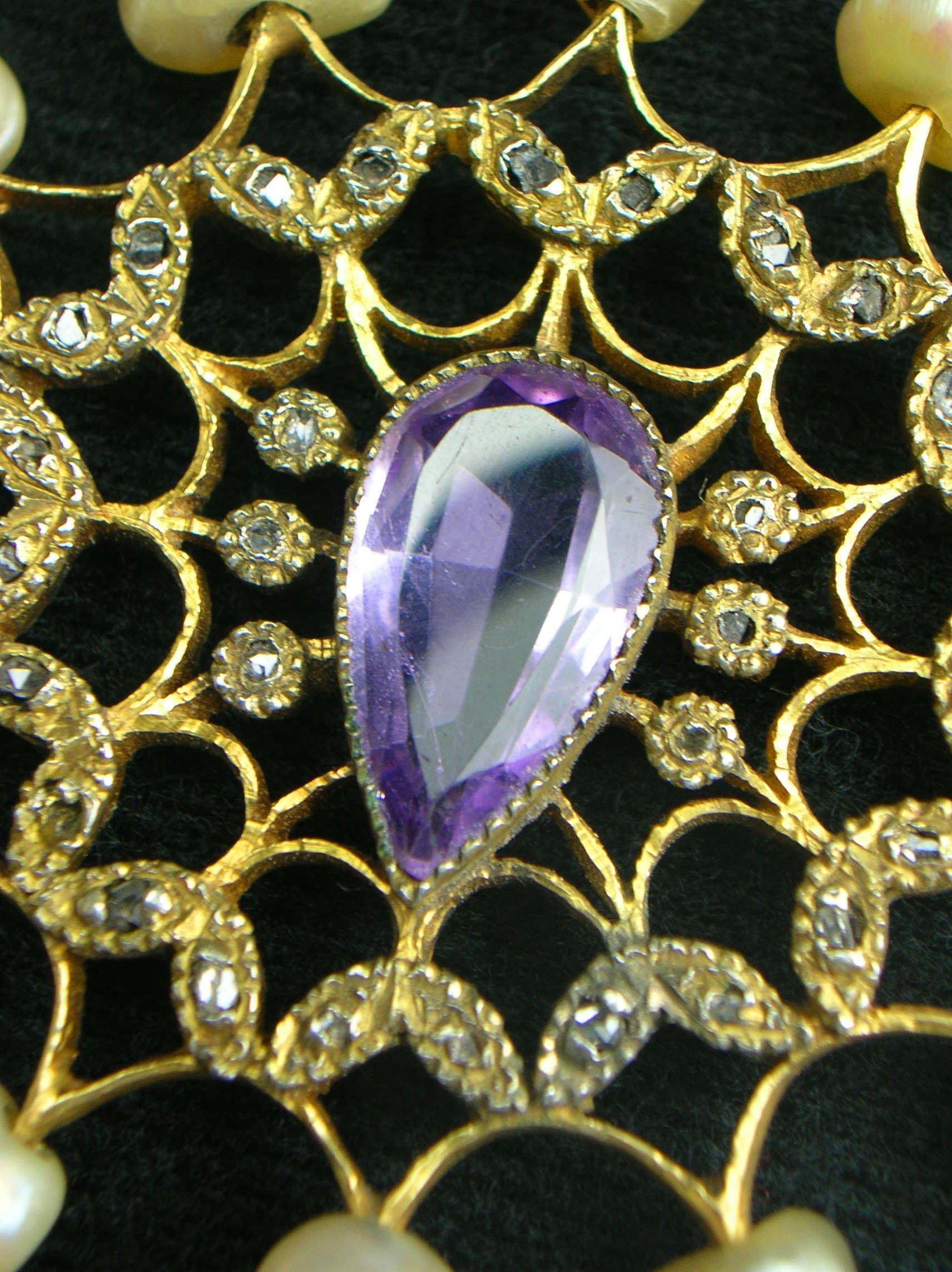 ROSARY: Showing hand faceted amethyst center / diamonds
