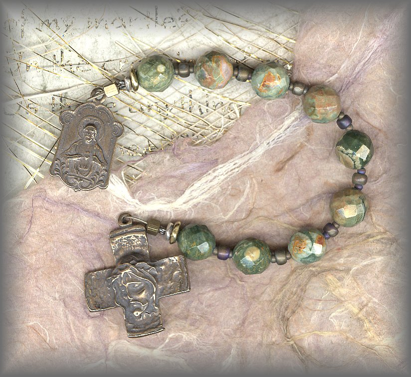 CHAPLET: closeup of faceted rhyolite beads and cross