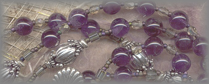 CATHOLIC ROSARY: closeup of amethyst beads and silver