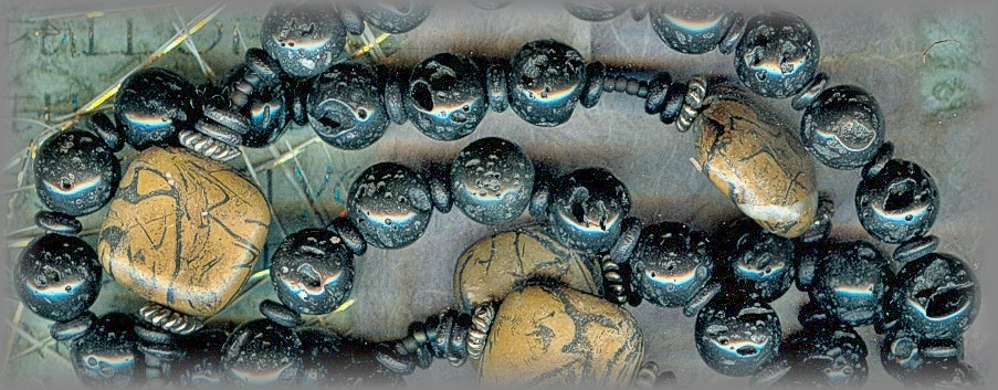 ROSARIES: closeup of faceted Ave beads and slab Toumaline