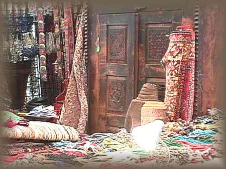 Antique carpets and furniture mingle with beads from the East